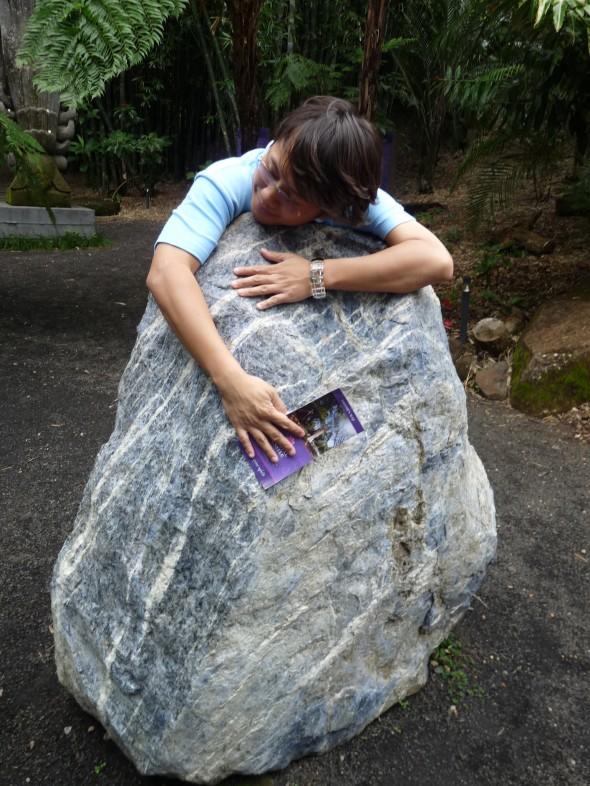 Franco hugging the calming rock