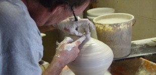 Potter John Gilson working in his studio
